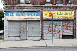 Surviving signage for the J&M Food Market and neighbor, Crown Heights, Brooklyn