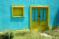 Yellow frames against a turquoise wall, Surf City, New Jersey