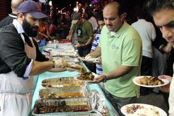 Last call at the serving line, annual iftar feast, Balady Foods, Bay Ridge, Brooklyn
