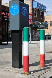 Bollards painted in the green, white, and red of Italy, Morris Park, Bronx