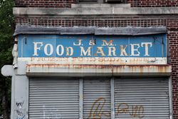 Surviving signage for the J&M Food Market, Crown Heights, Brooklyn