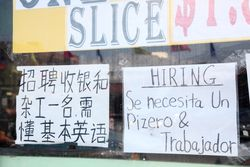 Help-wanted signs, in Chinese and Spanish, for a pizzaiolo, Bensonhurst, Brooklyn