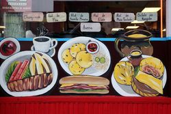 Window artwork and beverages menu, El Farolito, West New York, New Jersey