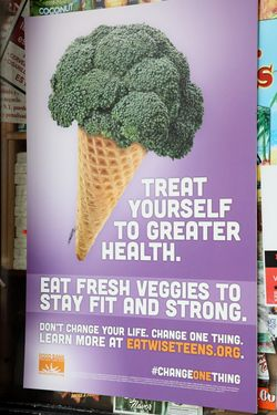 Broccoli in a cone, poster at Family Grocery, Frederick Douglass Boulevard, Manhattan
