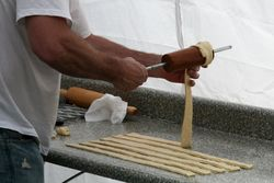 Winding dough for kurtos kalacs, Romania Day Festival, Broadway, Manhattan