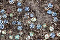 Used bottle caps pressed into decorative service, Hunts Point, Bronx