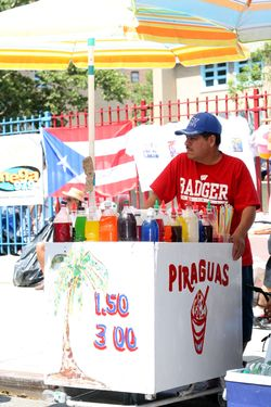 A piragua vendor at the Salsa Street Party, Spanish Harlem, New York