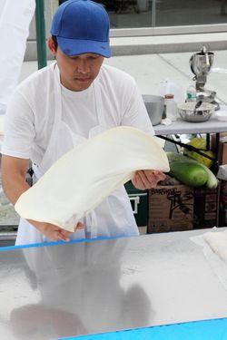 Flipping and stretching paratha dough, Burmese Bites, Manhattan
