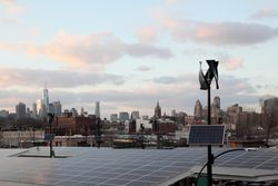 Northwest view from the Whole Foods roof deck, showing solar panels and wind turbines, Gowanus, Brooklyn