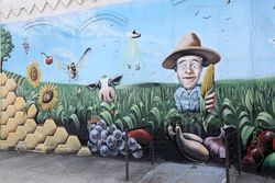 Mural of a farmer in his (fanciful) field (detail), Williamsburg, Brooklyn