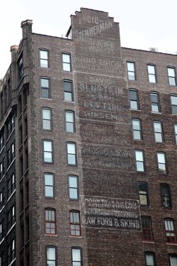 Surviving signage, including David Blustein & Bro, raw furs, ginseng,%22 West 27th Street, Manhattan