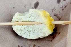Stuffed grilled egg (peeled, biteaway view), Cambodian sidewalk grill ...