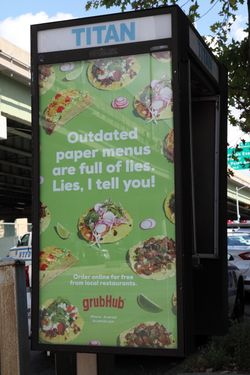 %22Outdated paper menus are full of lies, lies I tell you,%22 phone-kiosk ad for GrubHub, Tremont, Bronx