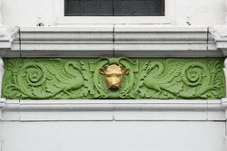 Decoration above a doorway, the former Saint Bernard Market, New Orleans