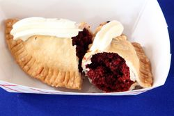 Red velvet cake empanada with cream cheese icing (cutaway view), YourPanadas, Vendy Plaza at La Marqueta, Park Avenue, Manhattan