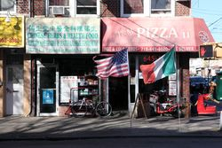 Chinese Herbal Therapy Center with signage in three alphabets, and J&M Pizza II flying two flags, Sheepshead Bay, Brooklyn