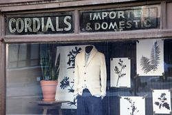 Cordials, imported & domestic, surviving signage from a liquor store, later the Liquor Store Bar, now a J Crew, West Broadway, Manhattan
