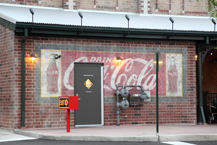 Coca-Cola, replica signage painted to suggest interruption by a newer doorway, Portillo's, South Loop, Chicago
