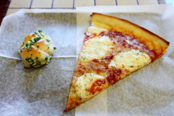 Sotto sopra slice with extra garlic (knot), Rizzo's Fine Pizza, Astoria, Queens
