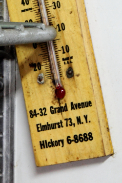 Refrigerator thermometer (detail of Elmhurst 73 postal zone and HIckory 6 telephone exchange), The Corner Deli, Maspeth, Queens