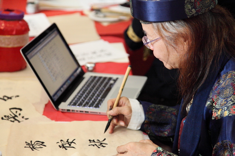 On-demand calligrapher and his electronic reference, Vietnamese Lunar New Year Celebration, Bronx Museum of the Arts, Bronx