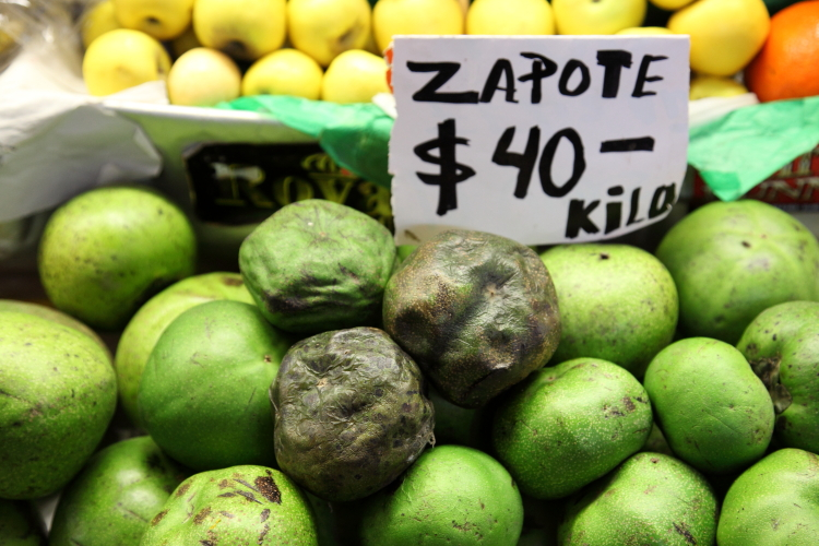 Zapotes negros (both green and fully ripe)  Fruteria Loma Bonita  Mercado de Coyoacan  Mexico City