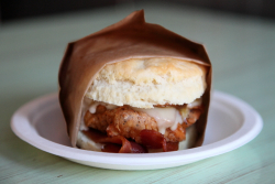 The Lenox  fried chicken with cheese  bacon  gravy  and onions on a biscuit  Morningside  Malcolm X Blvd  Manhattan