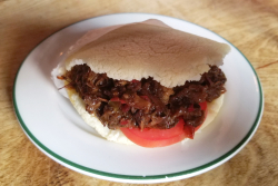 Arepa la morillo (featuring stewed goat)  El Cocotero  West 18th St  Manhattan