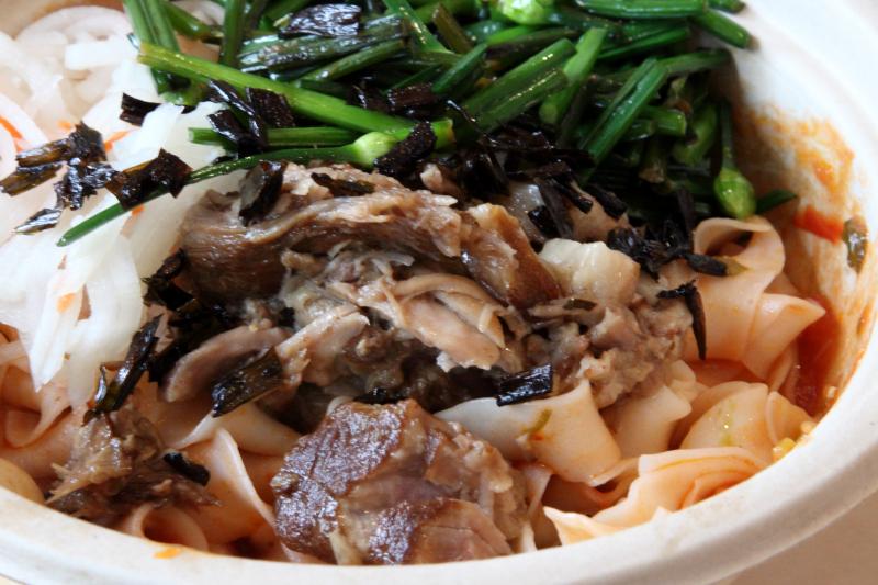 Tomato-pork noodle bowl  Junzi Kitchen  Broadway  Manhattan