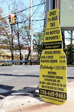 Bottle-shaped sign for Outerbridge Liquors (of Perth Amboy, New Jersey), Tottenville, Staten Island