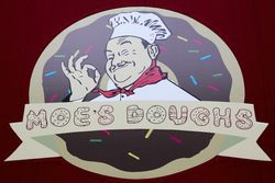 Moe's Doughs logo with winking chef and bent-donut lettering, Greenpoint, Brooklyn