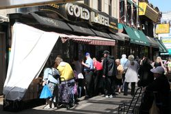Bargain-shoppers outside Gold Label, Brighton Beach, Brooklyn