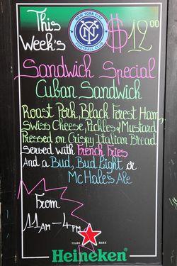 Sidewalk menu board, McHale's, West 51st St, Manhattan