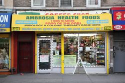 Ambrosia Health Foods and partially exposed, surviving coffee-shop signage, East Flatbush, Brooklyn