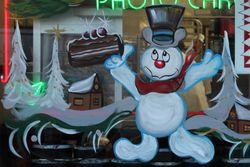 Tastee Pattee with Christmas decor (detail of Frosty holding black cake), East Flatbush, Brooklyn