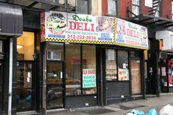 Doaba Deli with taxi artwork, checkered trim, and reflected taxis, Columbus Ave, Manhattan