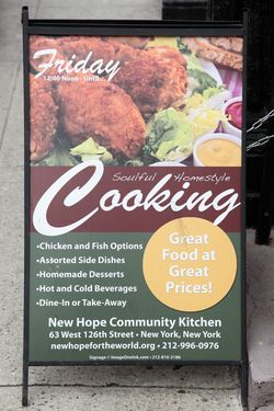 Sidewalk signboard, New Hope Community Kitchen, West 126th St, Manhattan