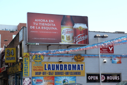Victoria Beer billboard directed at Mexican expats assimilating to New York, Woodside, Queens