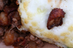 Duck sausage hash with two eggs over easy and duck chicharron, The Breakfast Shack truck, Astoria, Queens