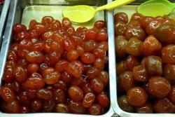 Frutas en almibar  syrup-preserved najanjas Chinas (kumquats) and  probably  duraznos (peaches)  Dulceria Alexis  Mercado de Coyoacan  Mexico City