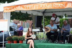 Performers and bystander  Armenian Church of the Holy Martyrs Street Festival  Bayside  Queens
