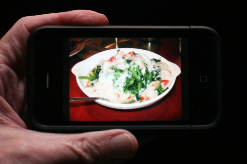 Crab meat sauce on snow pea leaves on iPhone