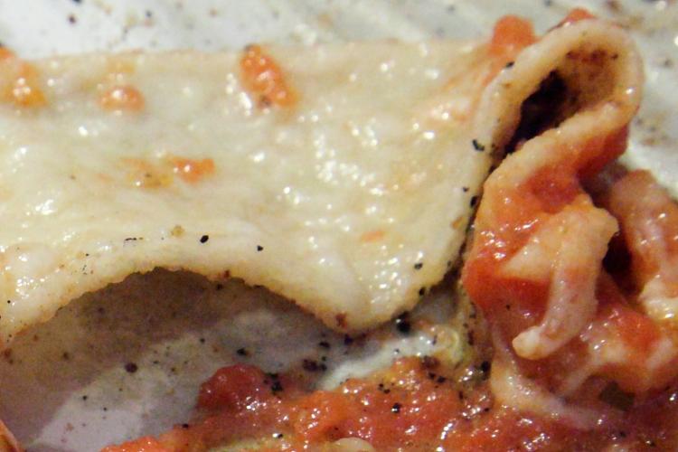 Sausage pie (detail of floppy crust), Modern Apizza, New Haven, Connecticut