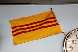 A flag no longer flown in its home country, seen in Brooklyn