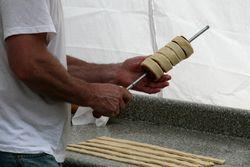 Winding dough for kurtos kalacs, Romania Day Festival, Broadway, Manhattan