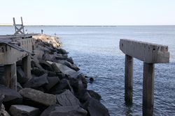 Fishing near the remains of a boardwalk destroyed by Hurricane Sandy, Atlantic City, New Jersey