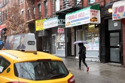 Gujrat Deli with taxi artwork and nearby taxi, Columbus Ave, Manhattan