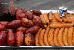 Street cart with roasted sweet potatoes and bananas  Mexico City