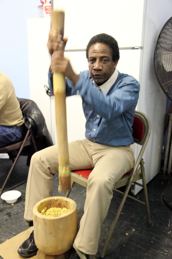 Pounding plantain at the Garifuna Day festival  Mott Haven  Bronx