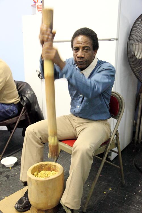 Pounding plantain at the Garifuna Day festival  Mott Haven  Bronx